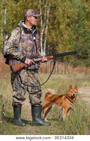 Hunter With Gun And Dog