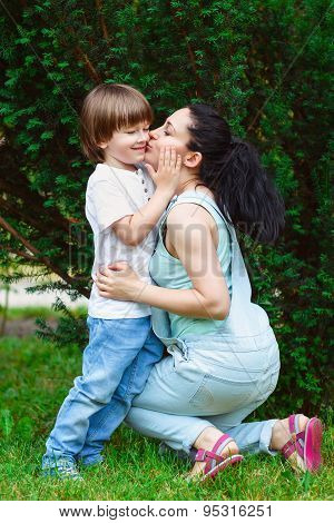 Loving mother kissing her son