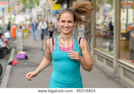 Happy Energetic Woman Jogging Through Town