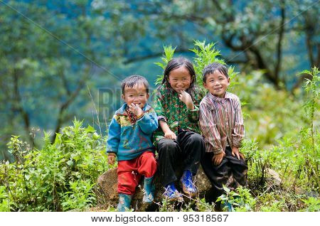 three ethnic children smile in Laocai, Vietnam