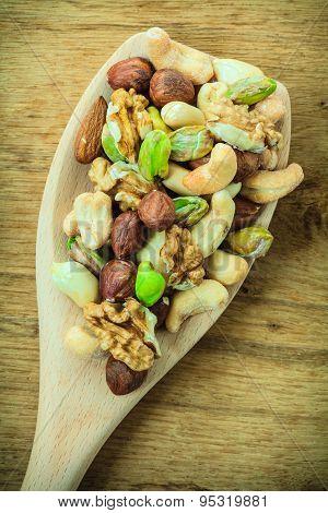 Varieties Of Nuts: Cashew, Pistachio, Almond.