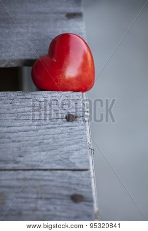 red heart on wooden table background, love valentines day background