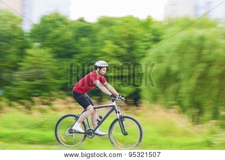 Cycling And Sport Concepts: Handsome Caucasian Rider Having A Bike Trip Outdoors In Forest.