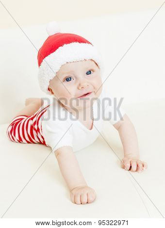 portrait of baby girl as Santa Claus