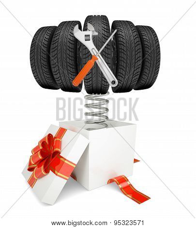 Gift box and car tires with tools on spring