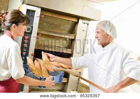 Fresh bread coming out of the oven