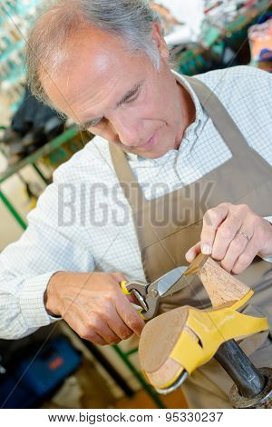 Experienced shoemaker hard at work