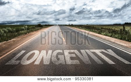 Longevity written on rural road