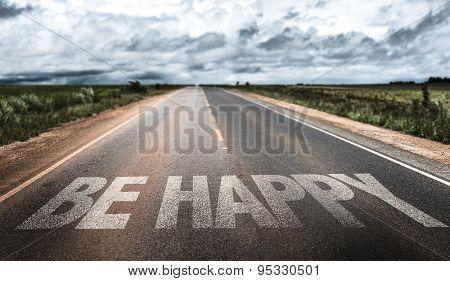 Be Happy written on rural road