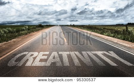 Creativity written on rural road