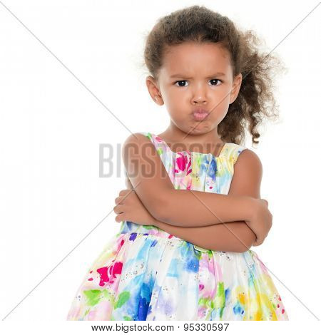 Cute small girl making a funny angry face isolated on white