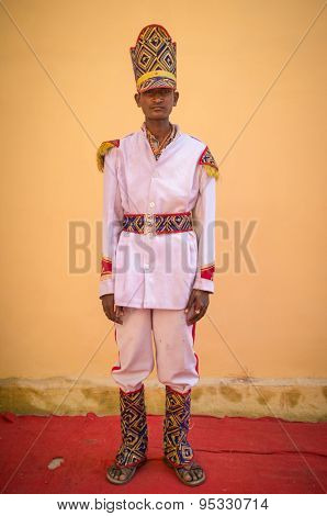 GODWAR REGION, INDIA - 15 FEBRUARY 2015: Young Indian musician dressed in wedding ceremony outfit with tall hat. Marriages in India are filled with ritual and celebration that go on for several days.