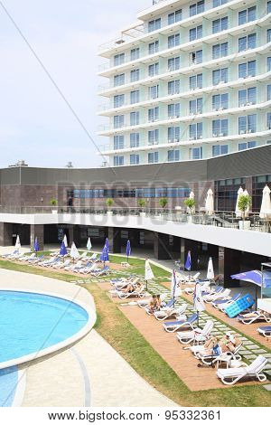 SOCHI, RUSSIA - JUL 27, 2014: People sunbathing on loungers around the pool of the Hotel Radisson Blu Paradise Resort and Spa