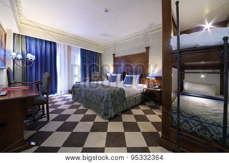 SOCHI, RUSSIA - JUL 27, 2014: Double family superior room with a double bed and a bunk bed in the Hotel Bogatyr