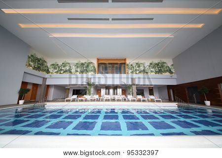 SOCHI, RUSSIA - JUL 27, 2014: Room with an indoor pool and sun loungers in the Hotel Radisson Blu Paradise Resort and Spa