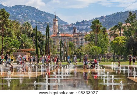 NICE, FRANCE - AUGUST 23, 2014: People among fountains at Promenade du Paillon - 12 hectares, 1.2km long new green pedestrian walkway area in the heart of Nice opened on October 26, 2013.