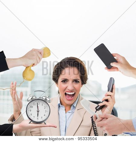 hand holding phone against furious businesswoman looking at camera and holding phone