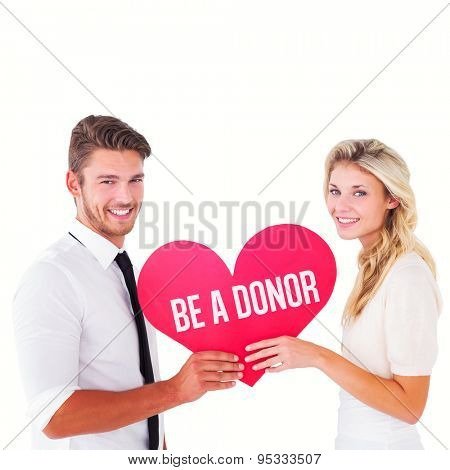 Attractive young couple holding red heart against be a donor