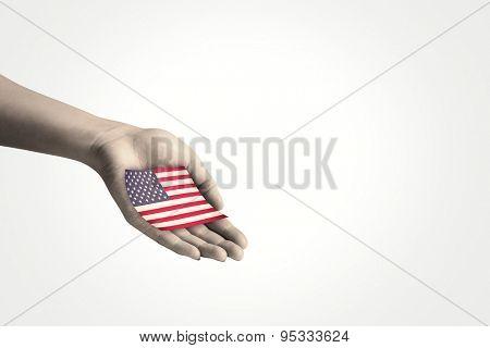 Hand presenting against usa national flag