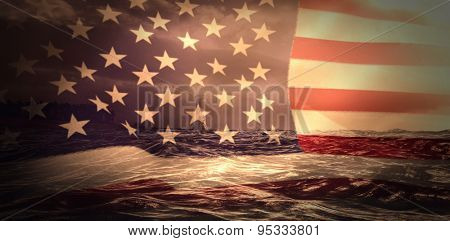 United states of america flag against stormy sea with lighthouse
