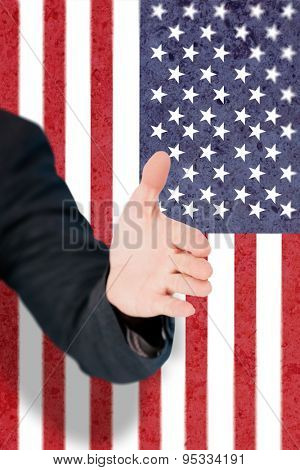Businessman extending arm for handshake against marble surface