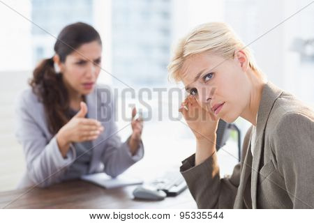 Businesswoman giving orders at her coworker in an office