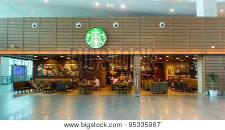 KUALA LUMPUR-MAY 06: Starbucks cafe in airport on May 06, 2014 in Kuala Lumpur, Malaysia. Starbucks Corporation is an American global coffee company and coffeehouse chain based in Seattle, Washington
