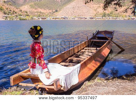 People on the boat on a beautiful lake