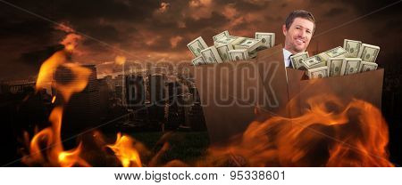 Businessman carrying bag of dollars against stormy sky over city