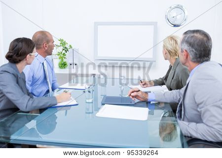 Business team looking at time clock in the meeting room