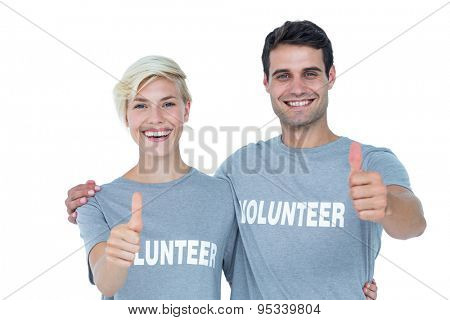 Cute couple of young volunteers gesturing thumbs up