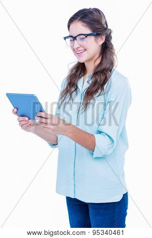 Pretty geeky hipster holding tablet on white background