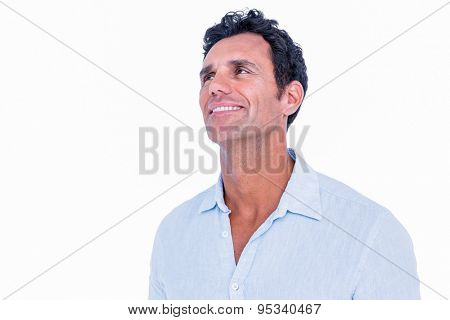 An handsome man looking away on white background