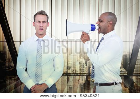 Businessman yelling with a megaphone at his colleague against window overlooking citty