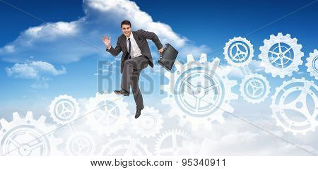 Happy businessman in a hurry against bright blue sky with clouds