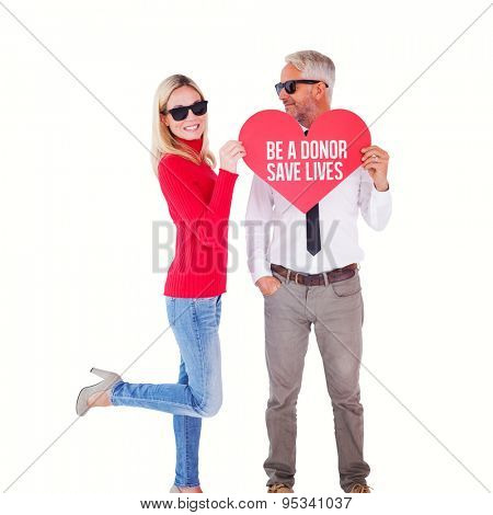 Cool couple holding a red heart together against be a donor save lives