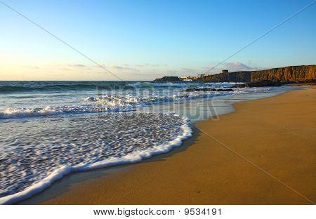 atlantic beach on fuerteventura island with foam