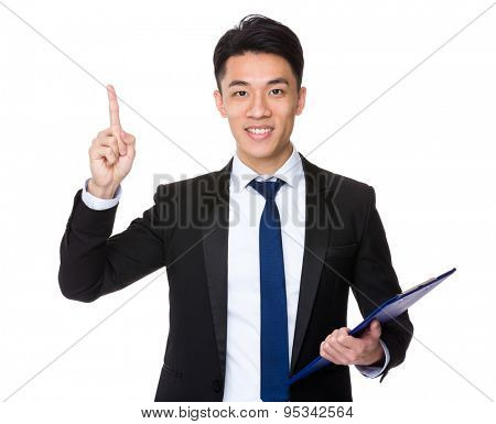 Young Businessman hold with clipboard and finger point up