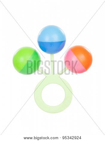 Colorful baby rattle with three balls isolated on white background