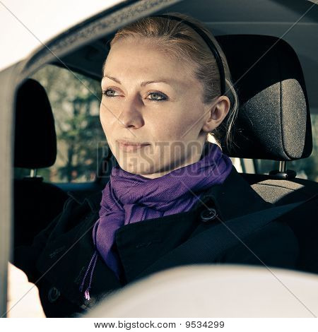 Woman Sitting In Car Getting Ready To Drive