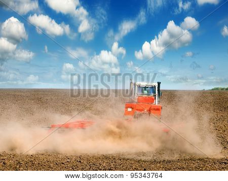 tractor in a field plowing