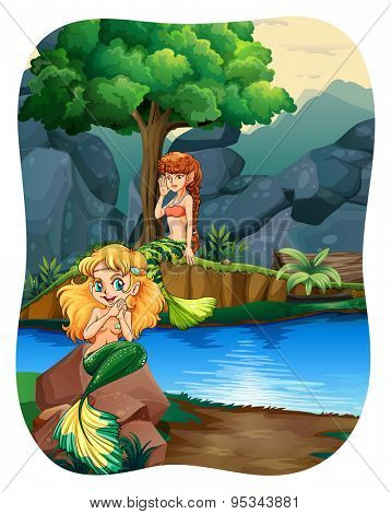 Two mermaids sitting on rock by the river