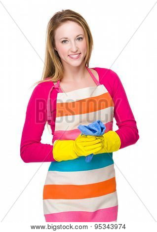Young woman with plastic gloves and rag