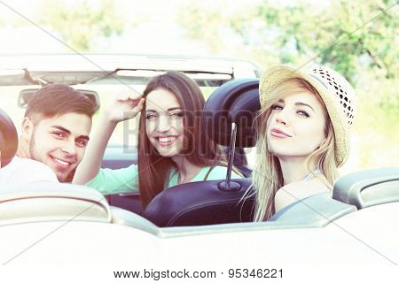 Young friends in cabriolet, outdoors