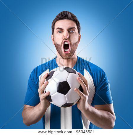 Fan on blue and white uniform celebrates on blue background