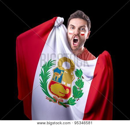 Fan holding the flag of Peru on black background