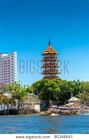 Temple at Chao Phraya river in Bangkok, Thailand.