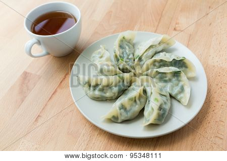 Chinese dumpling with a cup of tea