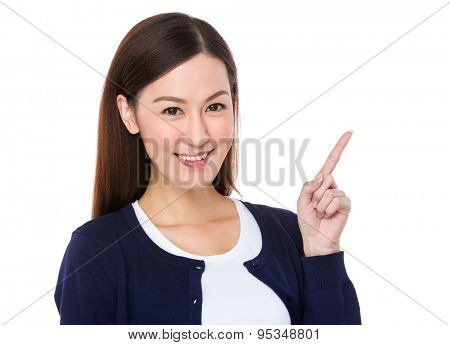 Asian young woman with finger point upwards for selling something