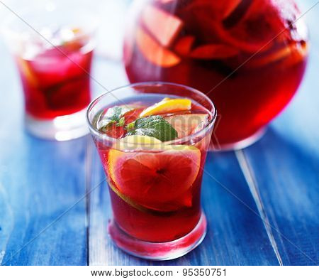 sangria with fruits and mint garnish in cup